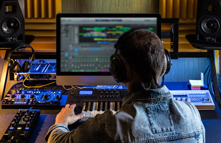 Photo for Men produce electronic music in project home studio. - Royalty Free Image
