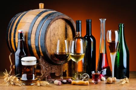 Foto de still life with different alcoholic drinks and wooden barrel - Imagen libre de derechos