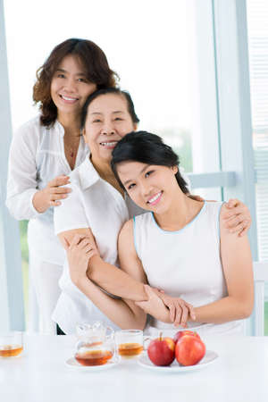 Photo for Three asian women standing behind the table - Royalty Free Image