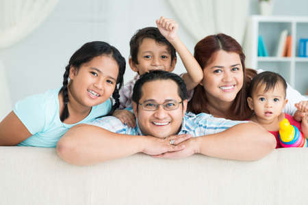 Photo for Portrait of a happy family posing at camera together - Royalty Free Image