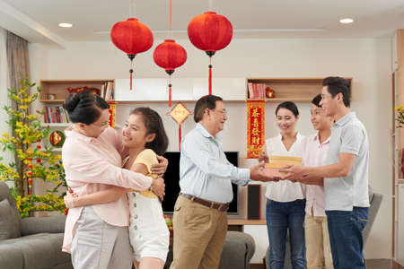 Photo for Asian family exchanging presents at Tet celebration - Royalty Free Image