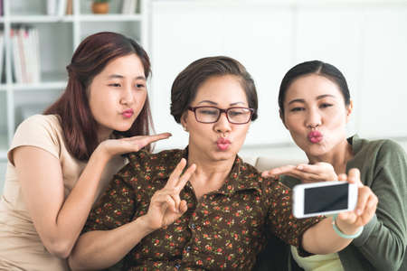Photo for Family making duck face while taking a selfie - Royalty Free Image