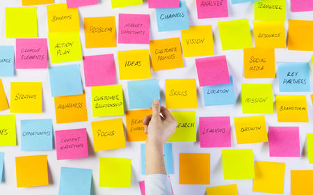 Photo for Hands of woman sticking adhesive notes on whiteboard - Royalty Free Image