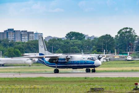 Foto de Kyiv, Ukraine - June 09, 2019: Motor Sich Antonov An-24 in Kyiv Sikorsky Airport - Imagen libre de derechos