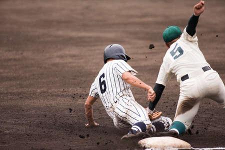 Photo for Sliding baseballgame The moment to hit - Royalty Free Image