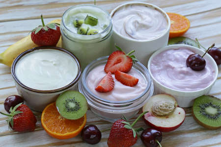Photo for assortment of different yogurt for breakfast with berries and fruits - Royalty Free Image