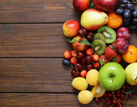 Foto de Different fruits and berries, healthy food - Imagen libre de derechos