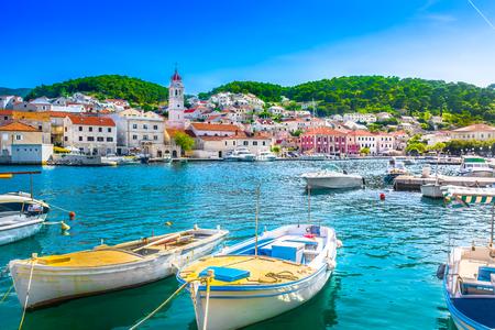 Foto de Seafront summer view at Pucisca town on Island Brac, Croatia. - Imagen libre de derechos