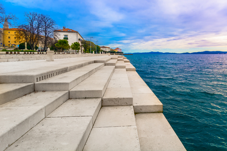 Foto de Scenic view at coastal town Zadar and famous landmark on city promenade, Sea Organ, Croatia Europe. - Imagen libre de derechos