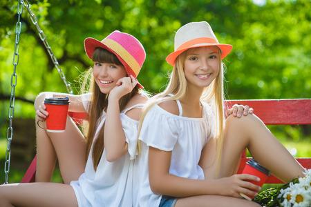 Photo for Joyful girlfriends having fun on swing outdoor. Friendship concept - Royalty Free Image