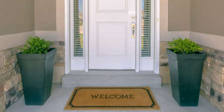 Photo for Front door with doormat plants and glass panel - Royalty Free Image