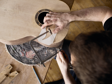 Photo for The process of making a cutaway on a classical guitar. - Royalty Free Image