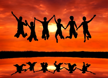 Photo for group of freedom teen friends jumping with joy at sunrise silhouetted - Royalty Free Image
