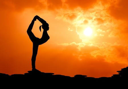 Photo pour beautiful woman practise yoga at sunset silhouetted - image libre de droit