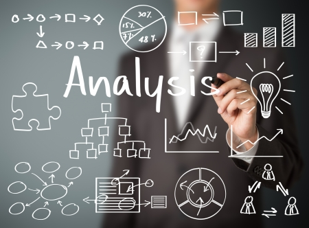 Foto de business man writing data analysis - Imagen libre de derechos