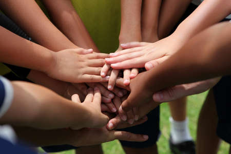 group of young people s hands