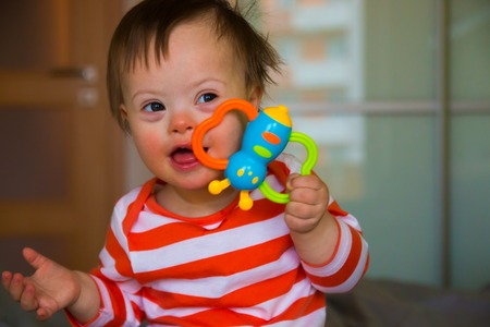 Photo for Portrait of cute baby boy with Down syndrome - Royalty Free Image