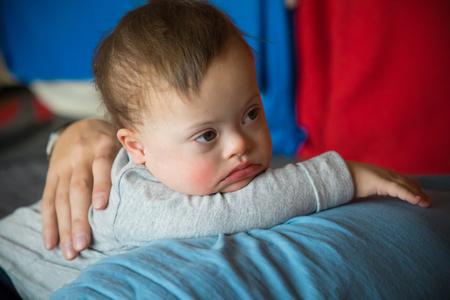 Foto de Portrait of cute baby boy with Down syndrome - Imagen libre de derechos