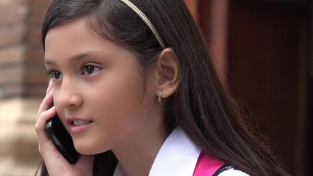 Foto de Youthful Colombian Girl Using Cell Phone - Imagen libre de derechos