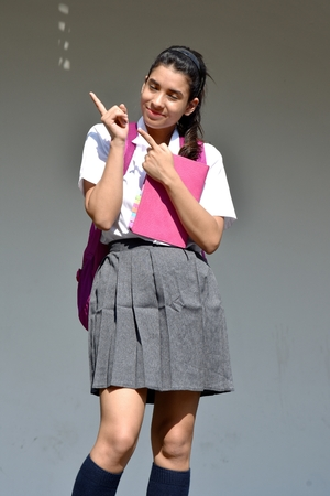 Photo pour Creative Cute Colombian Person Wearing School Uniform - image libre de droit