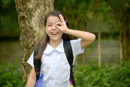 Photo for Minority Child Girl Student Searching Wearing School Uniform With Notebooks - Royalty Free Image