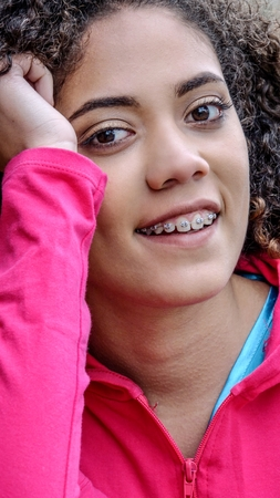 Foto de Young  Female Teen Athletic Girl With Braces - Imagen libre de derechos