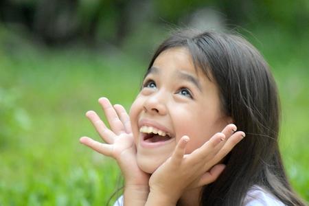 Foto de Surprised Youthful Minority Girl Child - Imagen libre de derechos