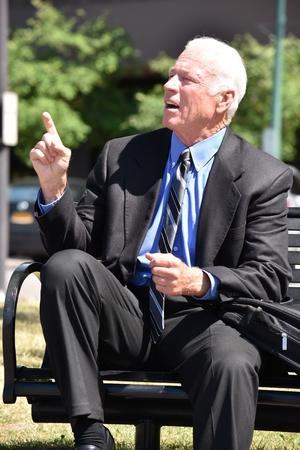 Photo pour Creative Senior Business Man Wearing Suit Sitting - image libre de droit