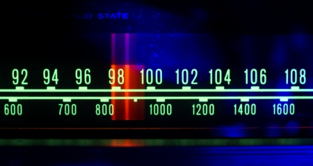 Photo for a glowing radio with the marker running through the different stations and frequencies - Royalty Free Image