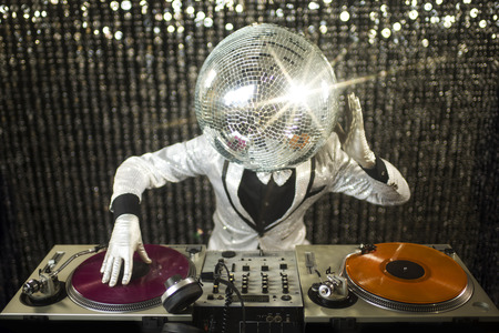 Photo for introducing mr discoball. a cool club character DJing in a club - Royalty Free Image