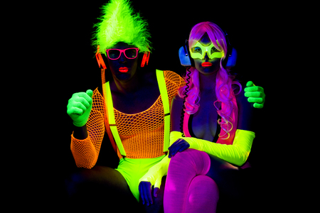 Photo for sexy couple disco party dancers posing in UV costume - Royalty Free Image