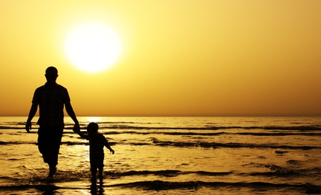 Photo for child with his father at sea. Sunset - Royalty Free Image