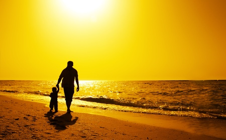 Photo for Dad and child on the beach at at sunset - Royalty Free Image