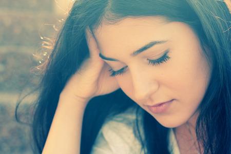 Outdoor portrait of a sad teenage girl