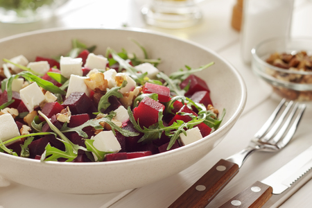 Photo for Vegetable salad with beetroot, arugula and feta for weight loss after holidays. Bowl of healthy diet food. - Royalty Free Image