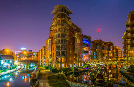 Photo for Night view of brick buildings alongside a water channel in the central Birmingham, England  - Royalty Free Image