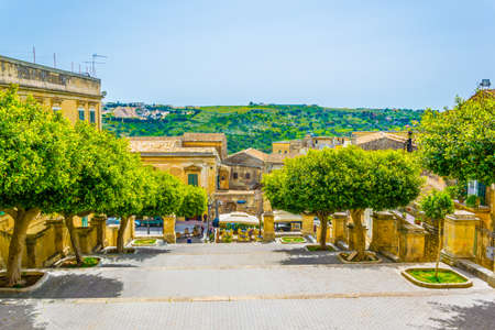 Photo for View of a small square in front of the Chiesa di san Giovanni Evangelista in Modica, Sicily, Italy  - Royalty Free Image