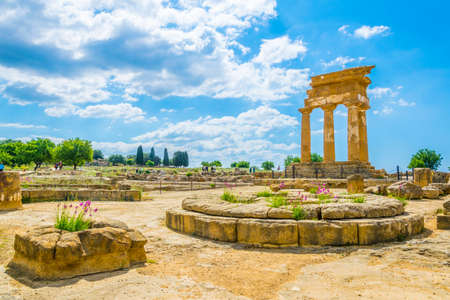 Photo for View of ruins of the temple of Castore and Polluce in the Valley of temples near Agrigento in Sicily, Italy  - Royalty Free Image