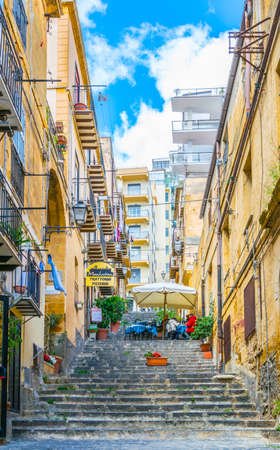Photo for AGRIGENTO, ITALY, APRIL 22, 2017: View of a narrow street in the historical city of Agrigento in Sicily, Italy - Royalty Free Image