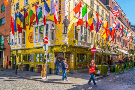Photo for DUBLIN, IRELAND, MAY 9, 2017: People are strolling through a busy street in the Temple bar district of Dublin, Ireland - Royalty Free Image