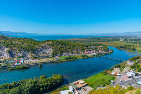 Photo for Aerial view of Buna river and adjacent village near entrance to Skadar lake in Albania - Royalty Free Image