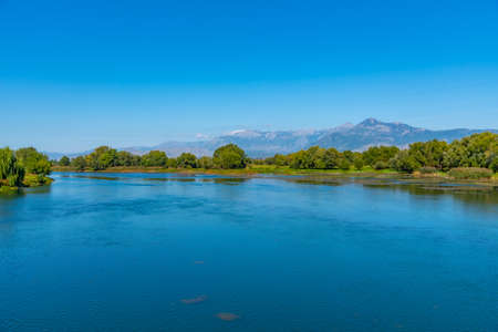 Photo for Mountains reflecting on Buna river in Albania - Royalty Free Image