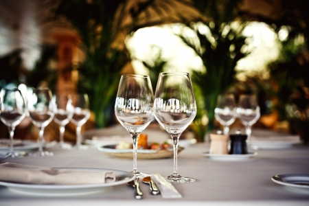 Photo for Empty glasses set in restaurant - Royalty Free Image