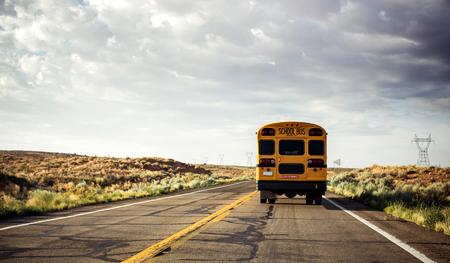 Photo pour Yellow school bus on the road, USA - image libre de droit