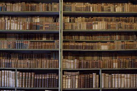 Foto de historic old books in ancient library, wooden bookshelf - Imagen libre de derechos