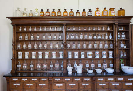 Photo for Empty chemical bottles in old vintage pharmacy - Royalty Free Image