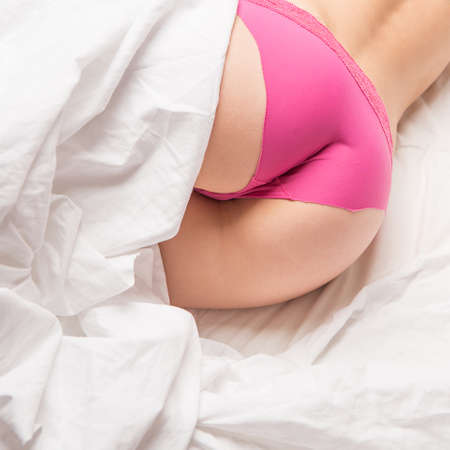 Photo for cute sexy girl curve ass lie in bed, purple panties - Royalty Free Image