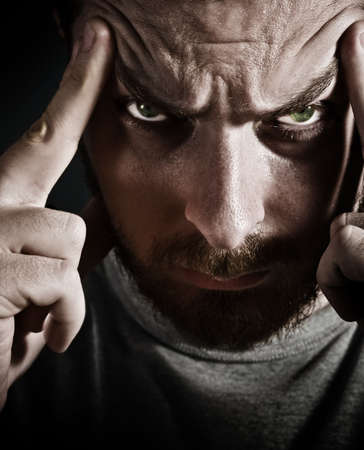 Close-up portrait of scary man looking very stressed and upset