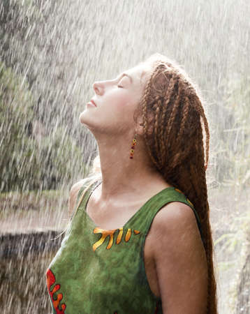Woman refreshing outdoor in the rain