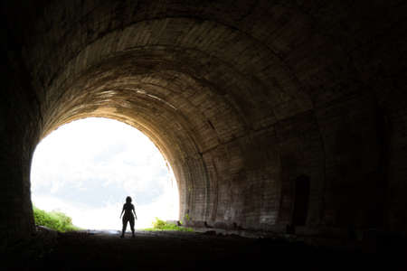 Silhouette in the abandoned train tunnel of Cantabria